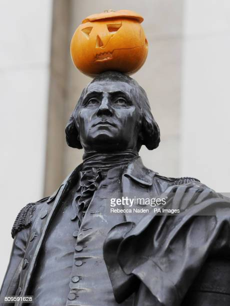 A Jack O'Lantern is left on the top of a statue of former US President George Washington next to the National Gallery in Trafalgar Square London