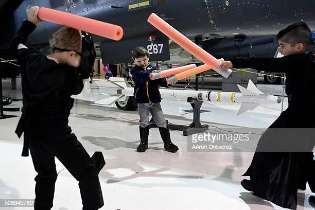 Jack Olenberger, dressed as Darth Vader , Adrian Salazar, dressed as Kylo Ren and Nolan Foster, dressed as Nolan Foster, play foam lightsaber battle...