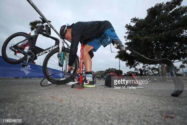 Jack O'Neil adjusts his bikes tire pressure prior to competing in the Legacy Triathlon-USA Paratriathlon National Championships on July 20, 2019 in...