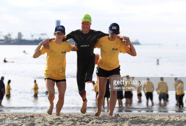 Jack O'Neil is helped to the pre-transition area while competing during the Legacy Triathlon-USA Paratriathlon National Championships on July 20,...