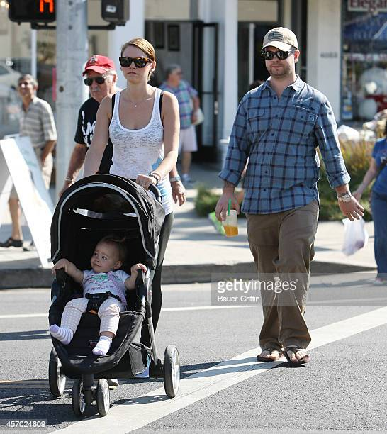 Jack Osbourne and his wife and daughter at the farmers market in Studio City on September 15 2013 in Los Angeles California