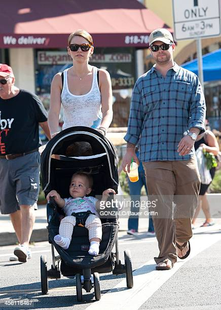 Jack Osbourne wife Lisa Stelly and baby Pearl Osbourne at the farmers market on September 15 2013 in Los Angeles California