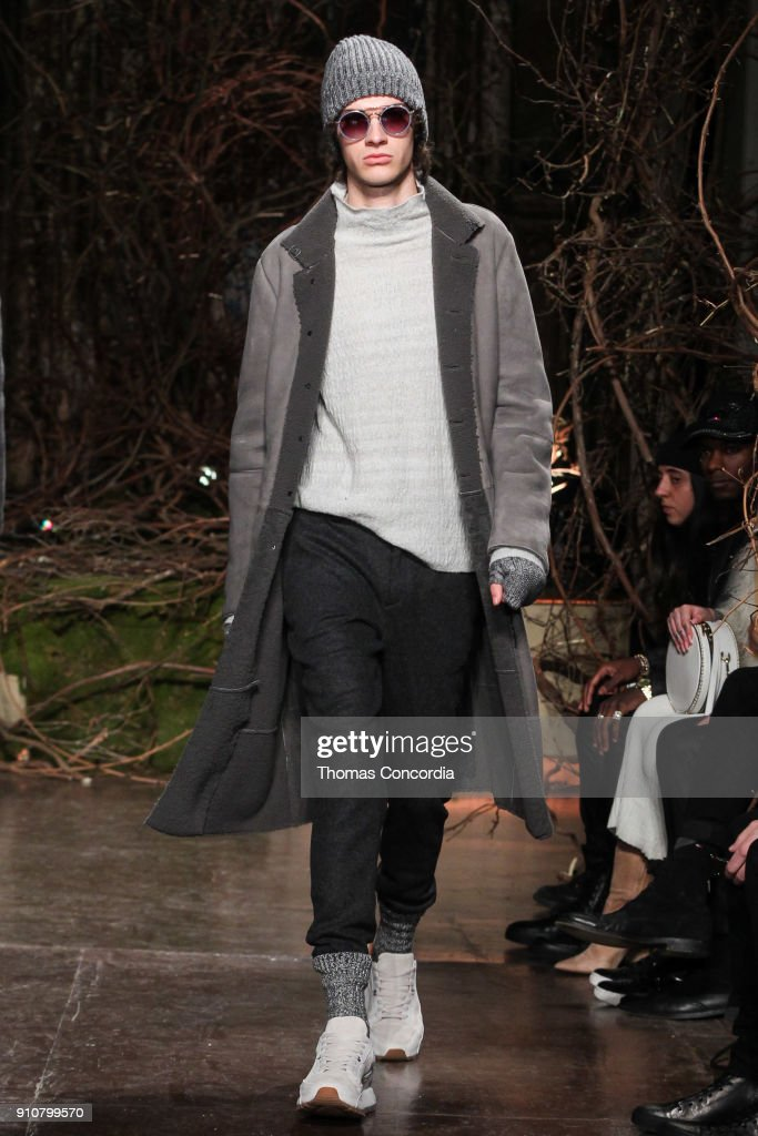Jack Page walks the runway wearing John Varvatos Fall/Winter 2018 with makeup by Chika Chan for Make-Up Pro and Hair by Yannik D'Is for Cultler/Redken at the Angel Orensanz Foundation on January 26, 2018 in New York City.