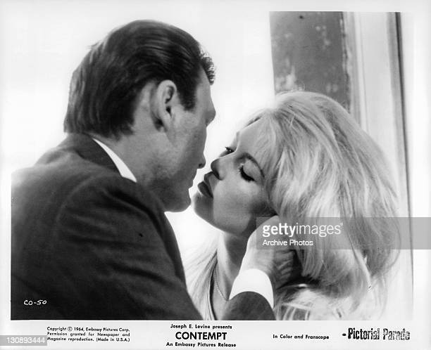 Jack Palance kissing Brigitte Bardot in a scene from the film 'Contempt' 1963