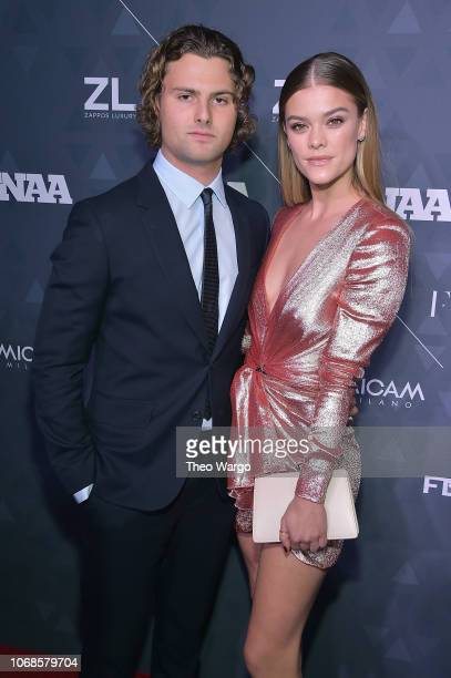 Jack Paris Brinkley Cook and model Nina Agdal attend the 2018 Footwear News Achievement Awards at IAC Headquarters on December 4 2018 in New York City