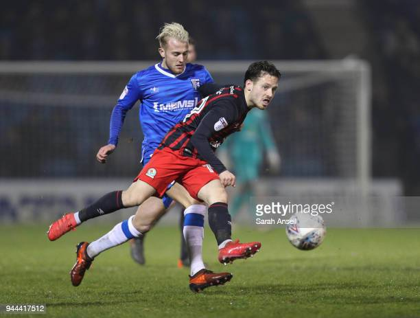 Jack Payne of Blackburn Rovers beats Gillingham's Liam Nash to the ball but sees his shot go wide during the Sky Bet League One match between...