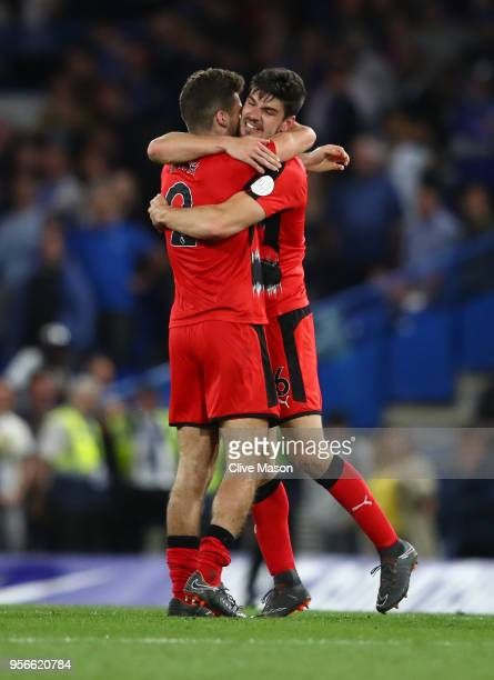 Jack Payne of Huddersfield Town and Tommy Smith of Huddersfield Town embrace after the Premier League match between Chelsea and Huddersfield Town at...