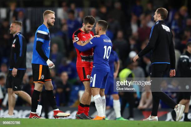 Jack Payne of Huddersfield Town is embraced by Eden Hazard of Chelsea during the Premier League match between Chelsea and Huddersfield Town at...