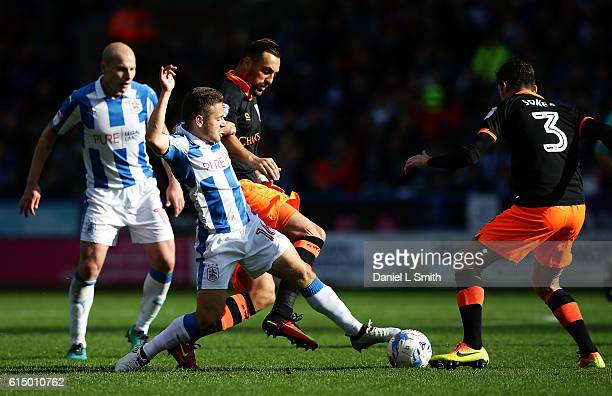 Jack Payne of Huddersfield Town under pressure from Atdhe Nuhiu of Sheffield Wednesday during the Sky Bet Championship match between Huddersfield...