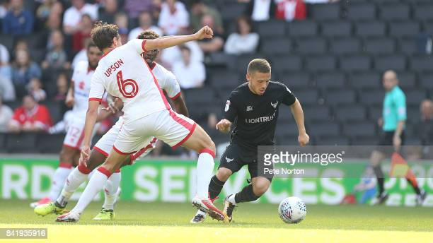 Jack Payne of Oxford United moves past Ed Upson of Milton Keynes Dons during the Sky Bet League One match between Milton Keynes Dons and Oxford...