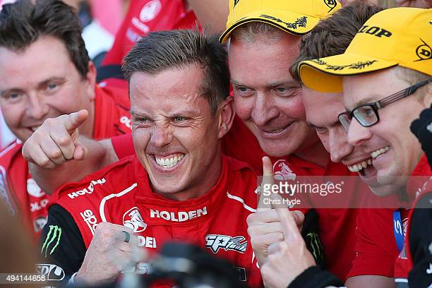 Jack Perkins and James Courtney of the Holden Racing Team Holden VF Commodore celebrates winning Race 27 at the Gold Coast 600 which is part of the...