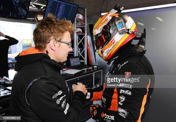 Jack Perkins driver of the Mobil 1 Boost Mobile Racing Holden Commodore ZB congratulates James Courtney driver of the Mobil 1 Boost Mobile Racing...