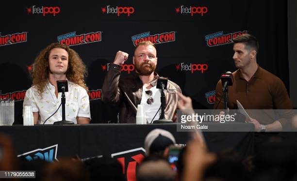Jack Perry aka Jungle Boy Jon Moxley and moderator Mick Rouse attend the All Elite Wrestling panel during 2019 New York Comic Con at Jacob Javits...