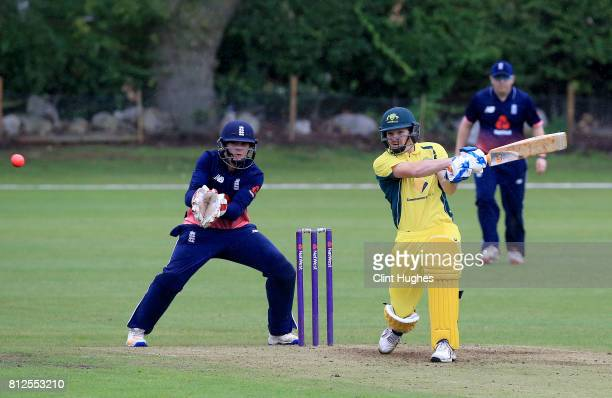 Jack Perry of England looks on as Brendan Westlake of Australia bats during the INAS Learning Disability TriSeries Trophy game between England and...