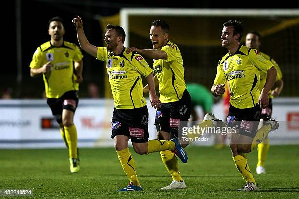 Jack Petrie of Heidelberg celebrates with team mates after scoring a goal during the FFA Cup match between Broadmeadow Magic FC and Heidelberg United...