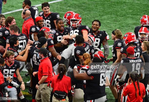 Jack Podlesny of the Georgia Bulldogs is congratulated by teammates after kicking the game-winning 53 yard field goal against the Cincinnati Bearcats...
