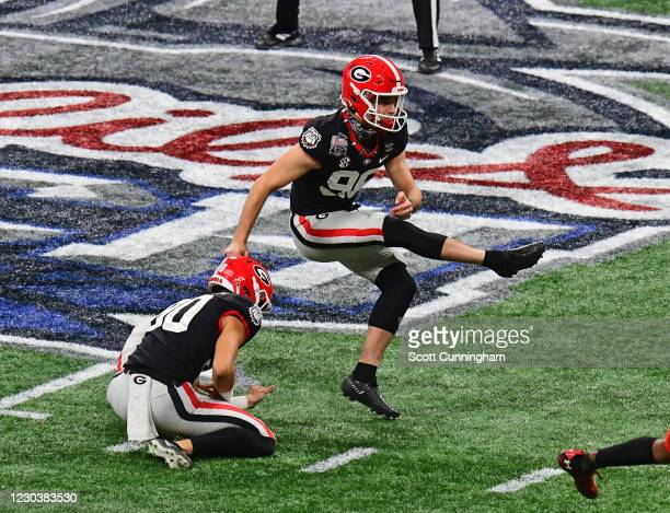 Jack Podlesny of the Georgia Bulldogs kicks the game-winning 53 yard field goal against the Cincinnati Bearcats during Chick-fil-A Peach Bowl at...