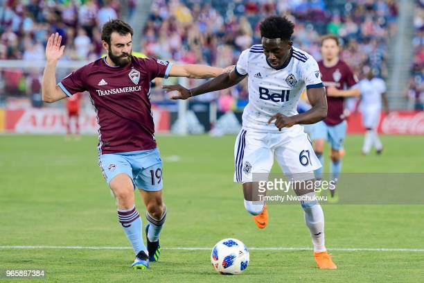 Jack Price of Colorado Rapids chases Alphonso Davies of Vancouver Whitecaps at Dick's Sporting Goods Park on June 1 2018 in Commerce City Colorado