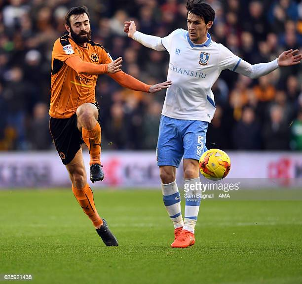 Jack Price of Wolverhampton Wanderers and Kieran Lee of Sheffield Wednesday during the Sky Bet Championship match between Wolverhampton Wanderers and...