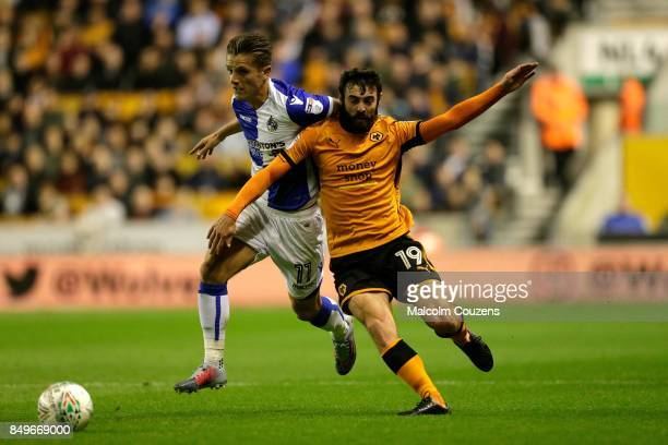 Jack Price of Wolverhampton Wanderers competes with Tom Nicholls of Bristol City during the Carabao Cup tie between Wolverhampton Wanderers and...