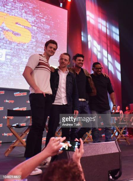 Jack Quaid Simon Pegg Karl Urban and Laz Alonso speak onstage at the Amazon's The Boys panel during New York Comic Con 2018 at Hammerstein Ballroom...