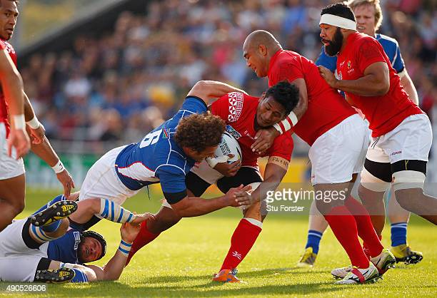Jack Ram of Tonga is tackled by Jacques Burger of Namibia during the 2015 Rugby World Cup Pool C match between Tonga and Namibia at Sandy Park on...