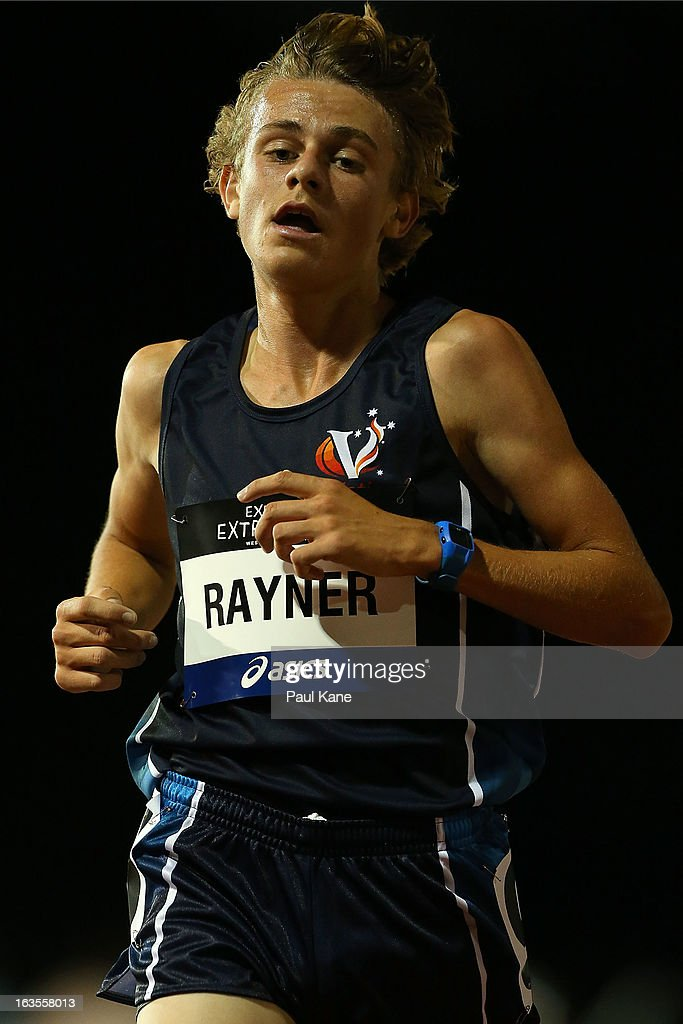 Jack Rayner of Victoria crosses the finish line to win the Men's under 20 5000 metre run during day one of the Australian Junior Championships at the WA Athletics Stadium on March 12, 2013 in Perth, Australia.