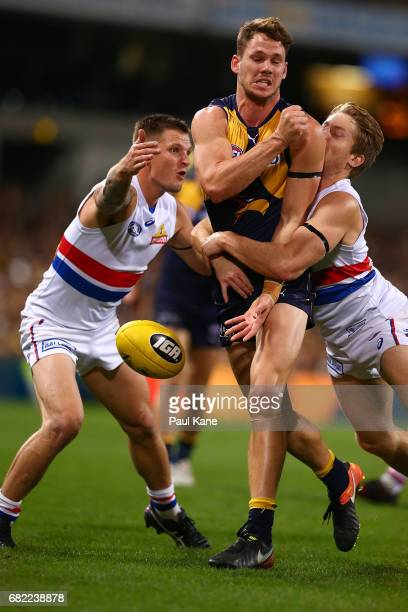 Jack Redden of the Eagles gets tackled by Clay Smith and Lachie Hunter of the Bulldogs during the round eight AFL match between the West Coast Eagles...