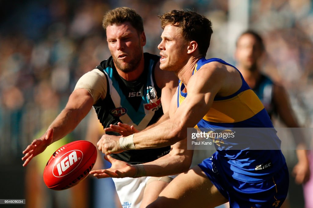 Jack Redden of the Eagles handballs against Brad Ebert of the Power during the round seven AFL match between the West Coast Eagles and the Port Adelaide Power at Optus Stadium on May 5, 2018 in Perth, Australia.
