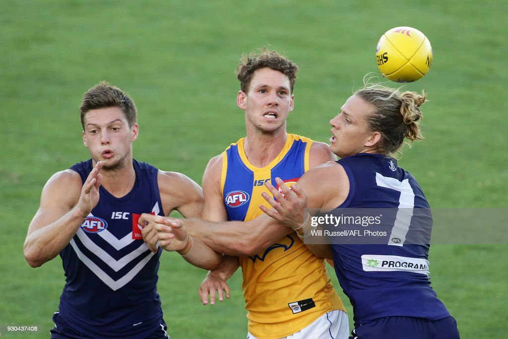 Jack Redden of the Eagles is tackled by Nat Fyfe of the Dockers during the JLT Community Series AFL match between the Fremantle Dockers and the West Coast Eagles at HBF Arena on March 11, 2018 in Perth, Australia.