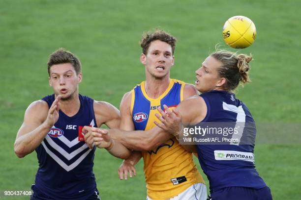 Jack Redden of the Eagles is tackled by Nat Fyfe of the Dockers during the JLT Community Series AFL match between the Fremantle Dockers and the West...