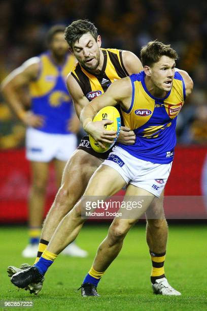 Jack Redden of the Eagles is tackled by Ricky Henderson of the Hawks during the round 10 AFL match between the Hawthorn Hawks and the West Coast...