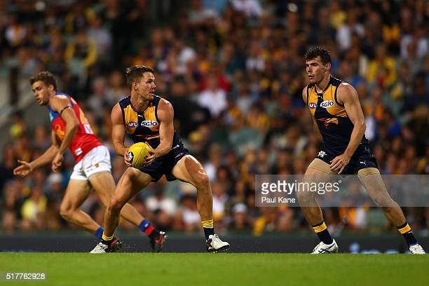 Jack Redden of the Eagles looks to handball during the AFL round one match between the West Coast Eagles and the Brisbane Lions at Domain Stadium on...