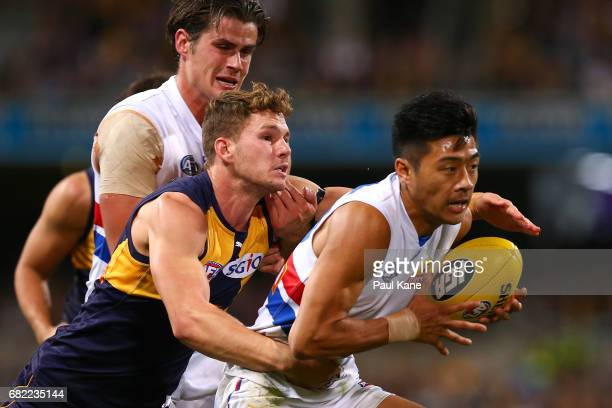 Jack Redden of the Eagles tackles Lin Jong of the Bulldogs during the round eight AFL match between the West Coast Eagles and the Western Bulldogs at...
