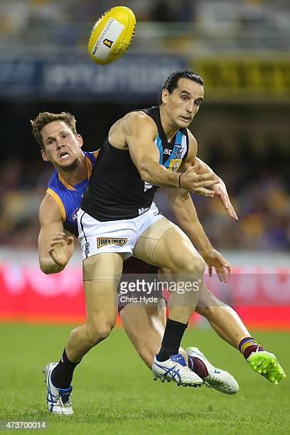Jack Redden of the Lions and Kane Mitchell of the Power compete for the ball during the round seven AFL match between the Brisbane Lions and the Port...
