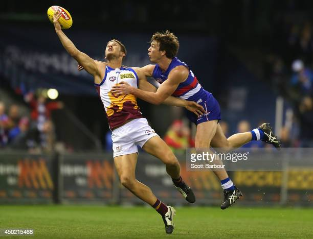 Jack Redden of the Lions and Liam Picken of the Bulldogs compete for the ball during the round 12 AFL match between the Western Bulldogs and the...