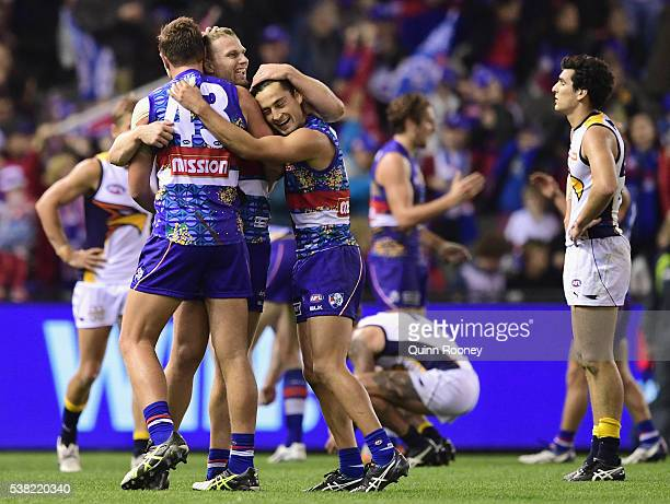 Jack Redpath Jake Stringer and Luke Dahlhaus of the Bulldogs celebrate winning the round 11 AFL match between the Western Bulldogs and the West Coast...