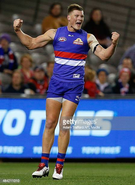 Jack Redpath of the Bulldogs celebrates a goal during the 2015 AFL round 20 match between the Western Bulldogs and the Melbourne Demons at Etihad...