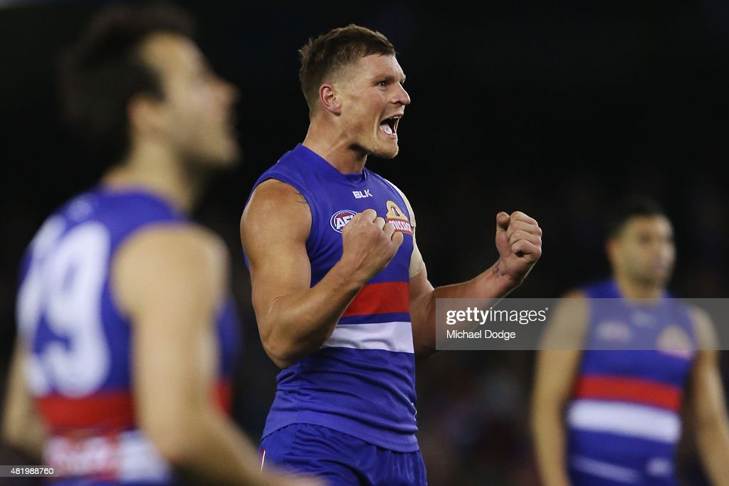 Jack Redpath of the Bulldogs celebrates a goal during the round 17 AFL match between the Western Bulldogs and the Collingwood Magpies at Etihad Stadium on July 26, 2015 in Melbourne, Australia.