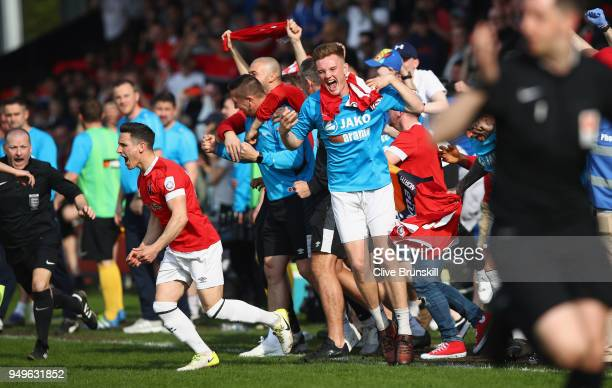 Jack Redshaw and Mark Shelton of Salford City celebrate at the final whistle after winning the National League North championship in their second to...