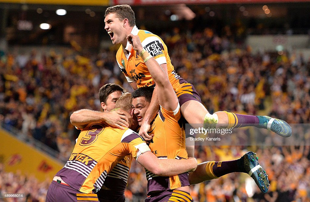 Jack Reed, Alex Glenn and Corey Oates of the Broncos celebrate a try during the NRL First Preliminary Final match between the Brisbane Broncos and the Sydney Roosters at Suncorp Stadium on September 25, 2015 in Brisbane, Australia.