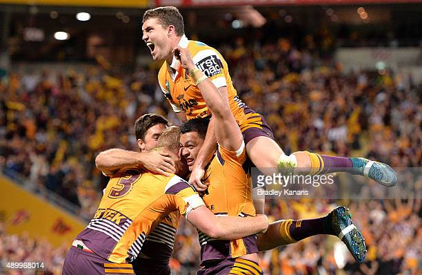 Jack Reed Alex Glenn and Corey Oates of the Broncos celebrate a try during the NRL First Preliminary Final match between the Brisbane Broncos and the...