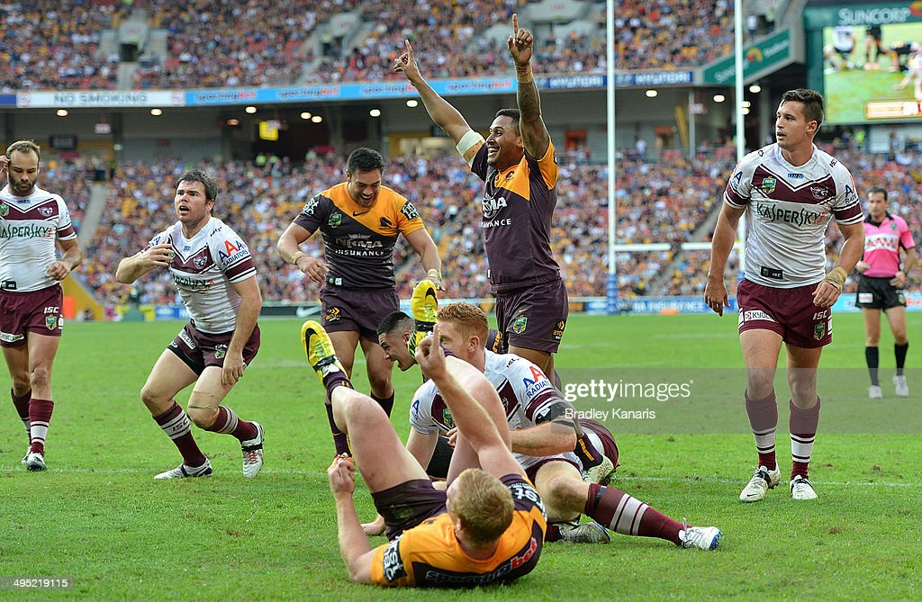 Jack Reed and Ben Barba of the Broncos claim a try during the round 12 NRL match between the Brisbane Broncos and the Manly-Warringah Sea Eagles at Suncorp Stadium on June 1, 2014 in Brisbane, Australia.
