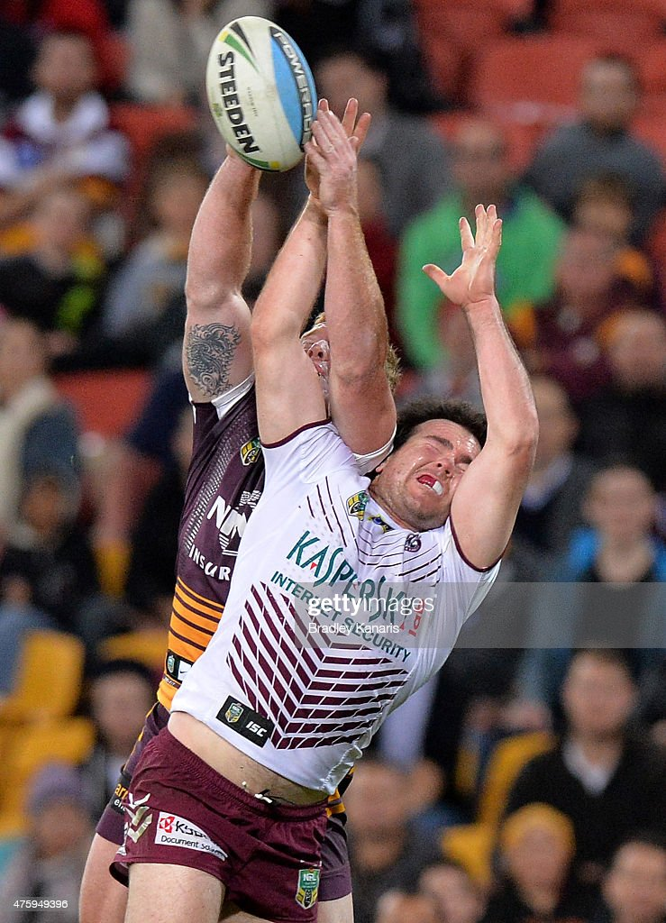 Jack Reed of the Broncos and Jamie Lyon of the Sea Eagles compete for the ball during the round 13 NRL match between the Brisbane Broncos and the Manly Sea Eagles at Suncorp Stadium on June 5, 2015 in Brisbane, Australia.