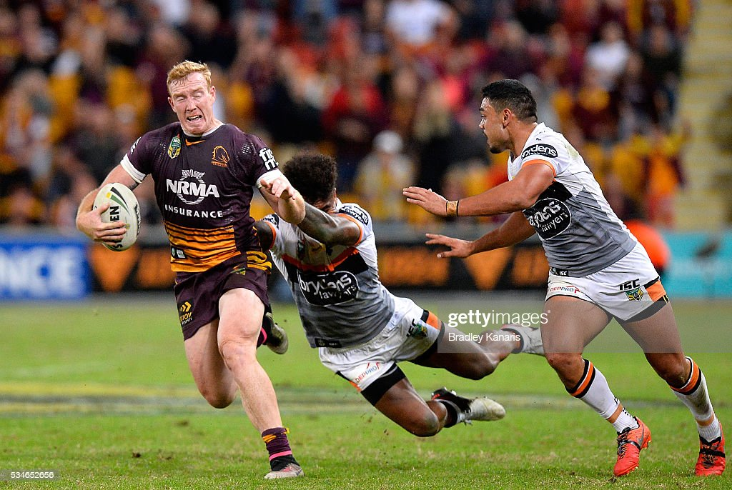 Jack Reed of the Broncos attempts to break away from the defence during the round 12 NRL match between the Brisbane Broncos and the Wests Tigers at Suncorp Stadium on May 27, 2016 in Brisbane, Australia.