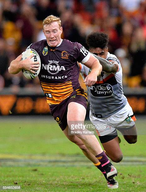 Jack Reed of the Broncos attempts to break away from the defence during the round 12 NRL match between the Brisbane Broncos and the Wests Tigers at...