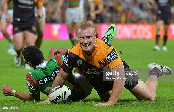Jack Reed of the Broncos celebrates after scoring a try during the round 8 NRL match between the Brisbane Broncos and the South Sydney Rabbitohs at...