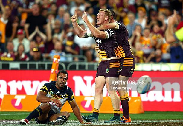 Jack Reed of the Broncos celebrates his try with team mate Matt Gillett during the 2015 NRL Grand Final match between the Brisbane Broncos and the...