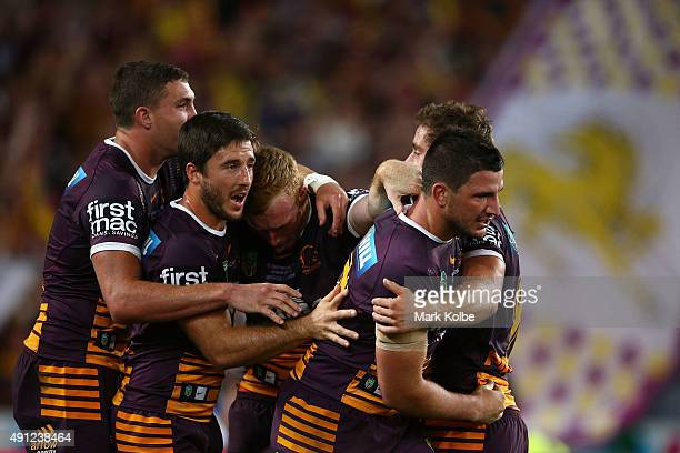 Jack Reed of the Broncos celebrates with team mates after scoring a try during the 2015 NRL Grand Final match between the Brisbane Broncos and the...