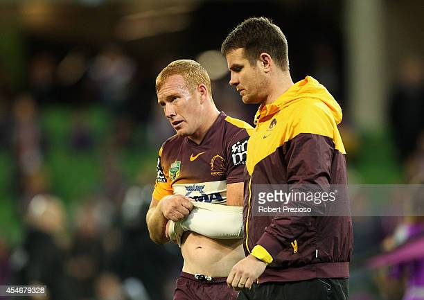 Jack Reed of the Broncos goes off with an injury during the round 26 NRL match between the Melbourne Storm and the Brisbane Broncos at AAMI Park on...